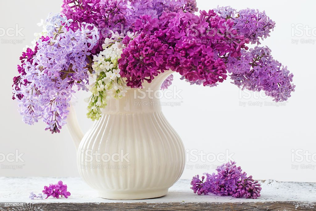 The beautiful lilac on white wooden table stock photo