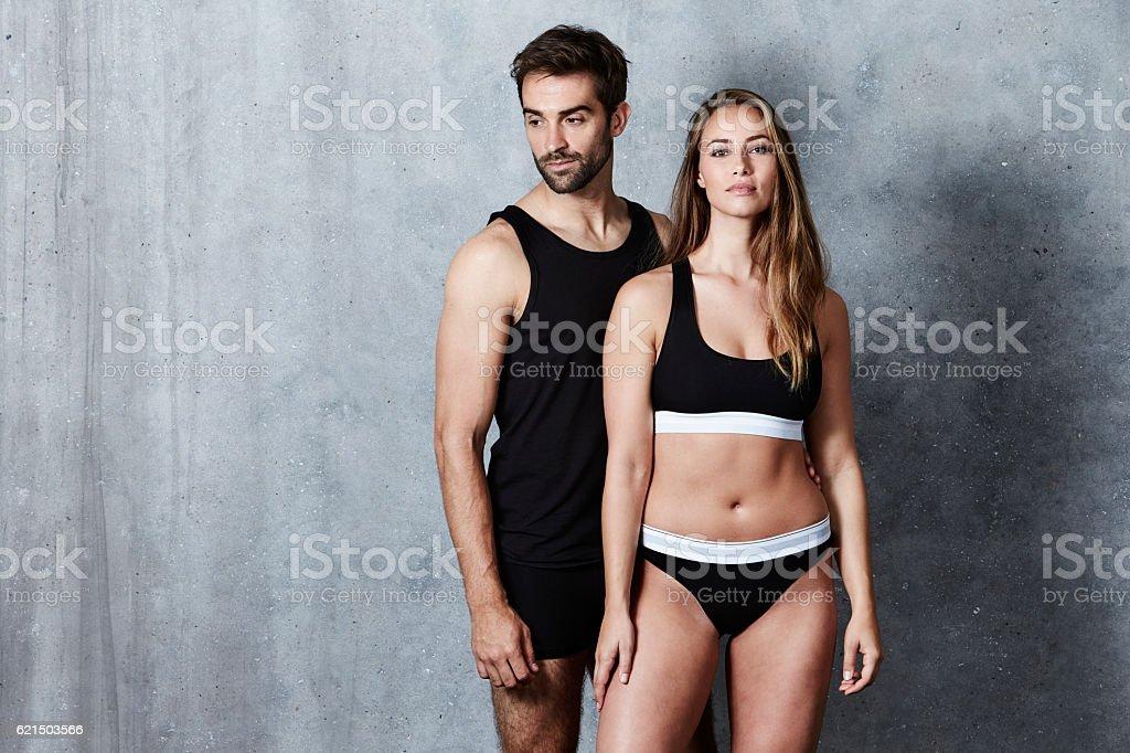 The beautiful people posing in underwear, studio stock photo