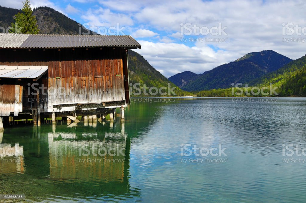 The beautiful Plansee with fisherman's has in Austria stock photo
