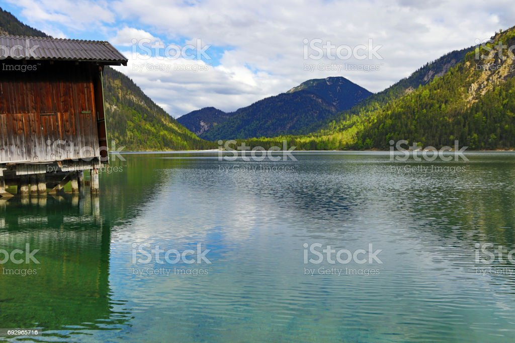 The beautiful Plansee with fisherman's hut in Austria stock photo