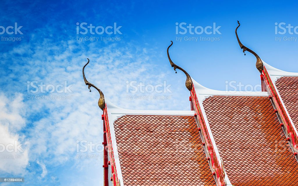 The Beautiful roof of temple in thailand with blue sky stock photo