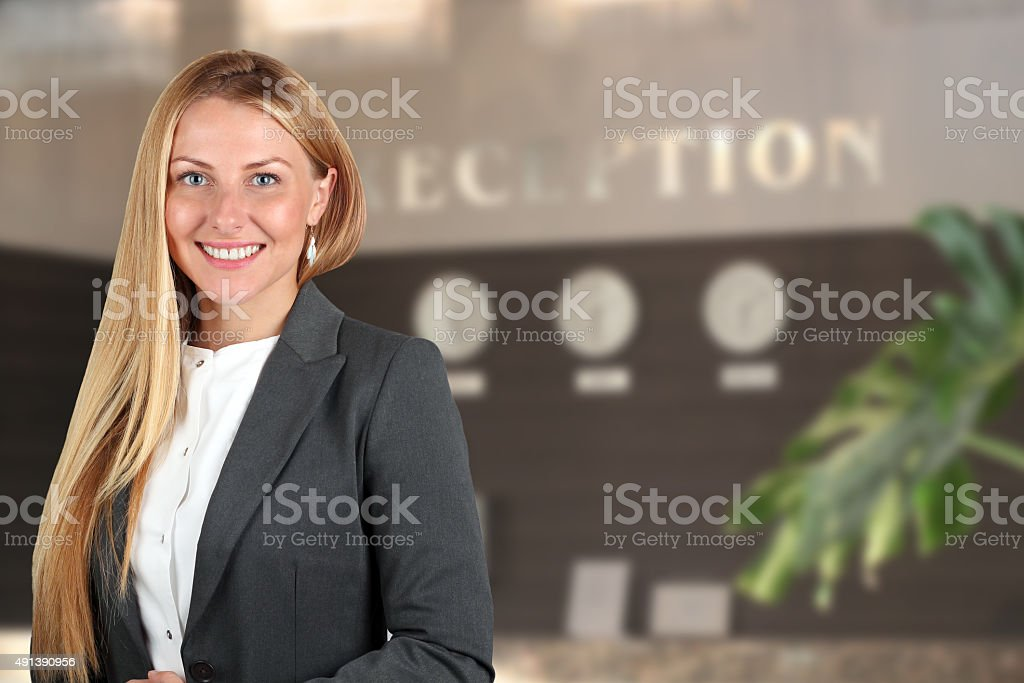 The Beautiful smiling business woman  portrait. Smiling female receptionist stock photo