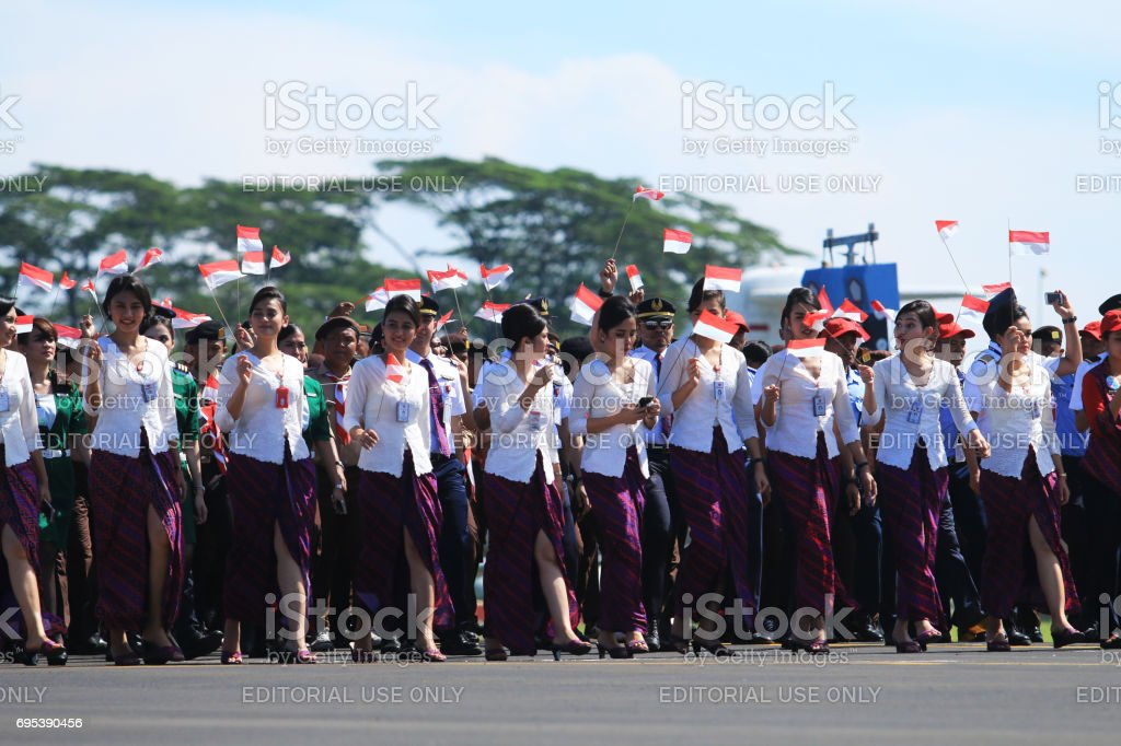 The beautiful stewardess attended the 71th anniversary of the Air Force, in lanud Halim Perdanakusuma, Jakarta. stock photo