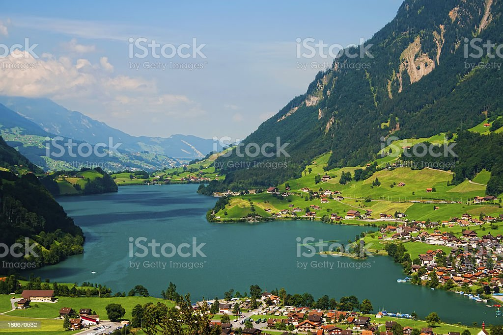 The beautiful valley between many massive mountains  stock photo
