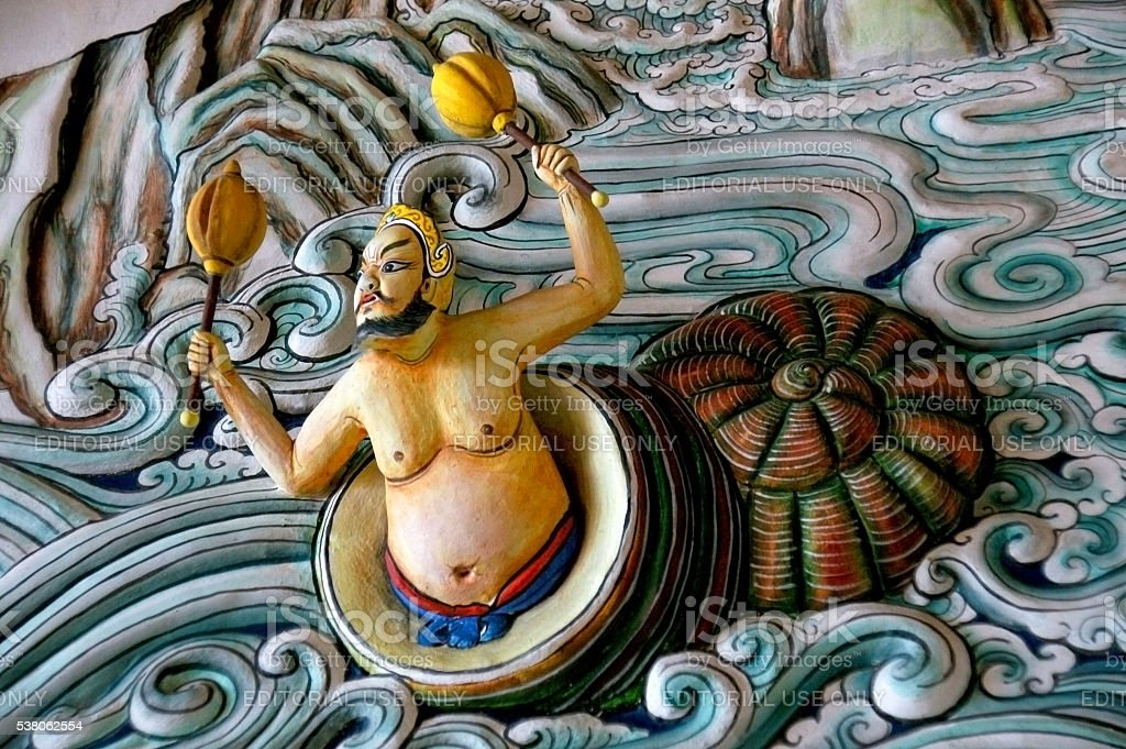 The beautiful wall sculpture made of stucco in Chinese temple. stock photo