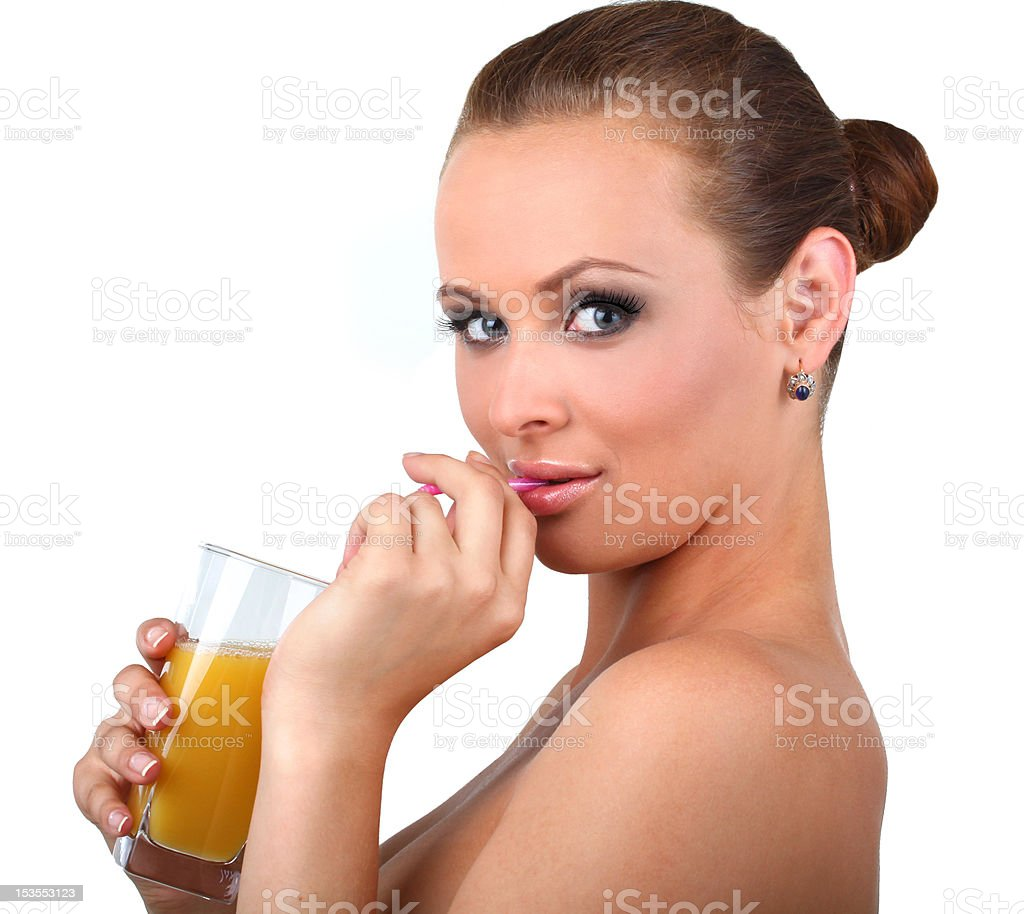 The beautiful woman drinks orange fresh royalty-free stock photo