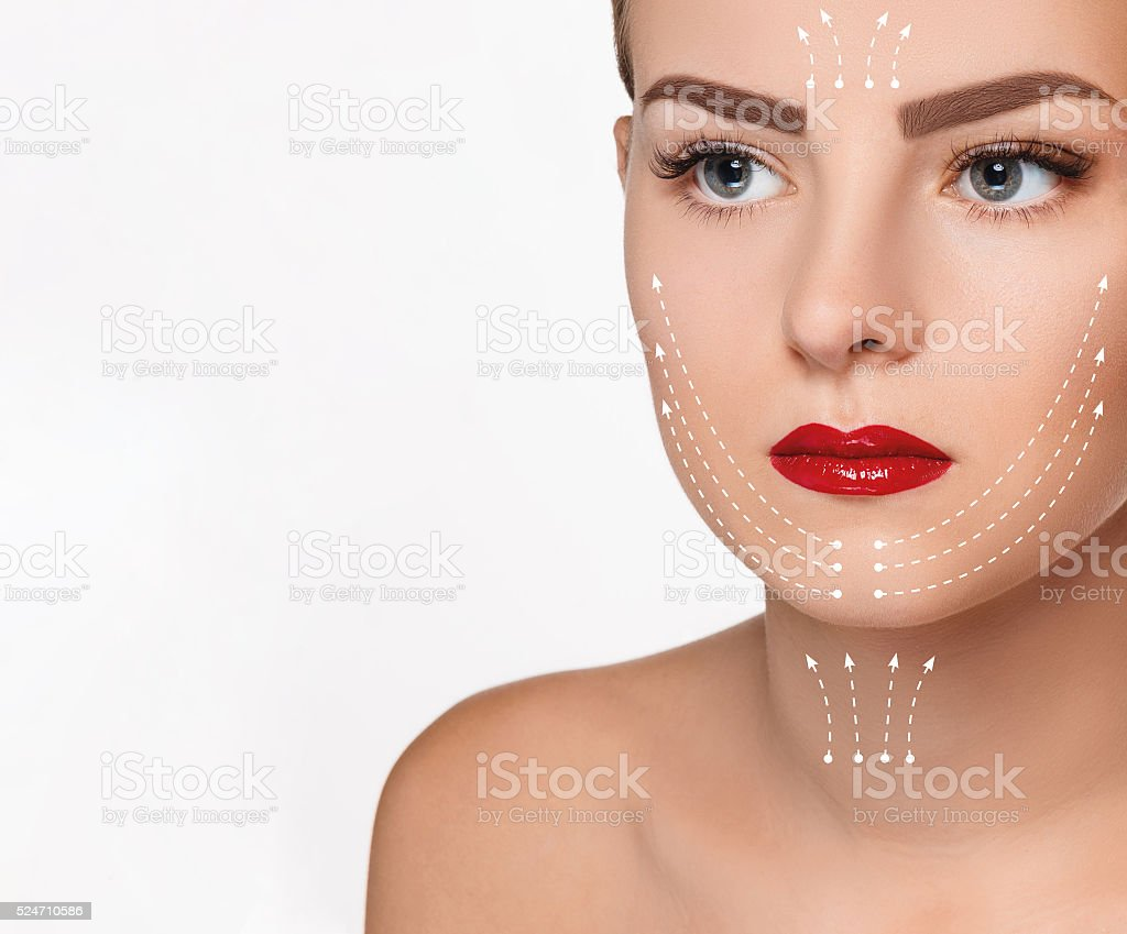 The beautiful woman face  with arrows close up over white stock photo