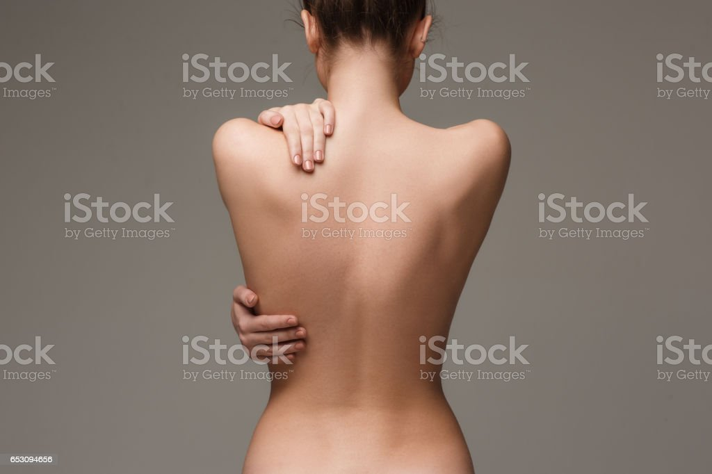The beautiful woman's body on gray background stock photo