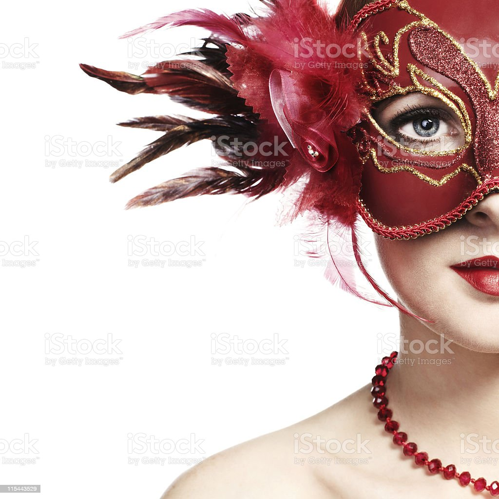 The beautiful young woman in a red venetian mask stock photo