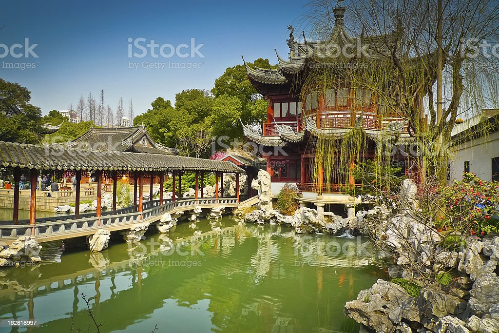 The beautiful Yuyuan Gardens with a pond and a pagoda stock photo