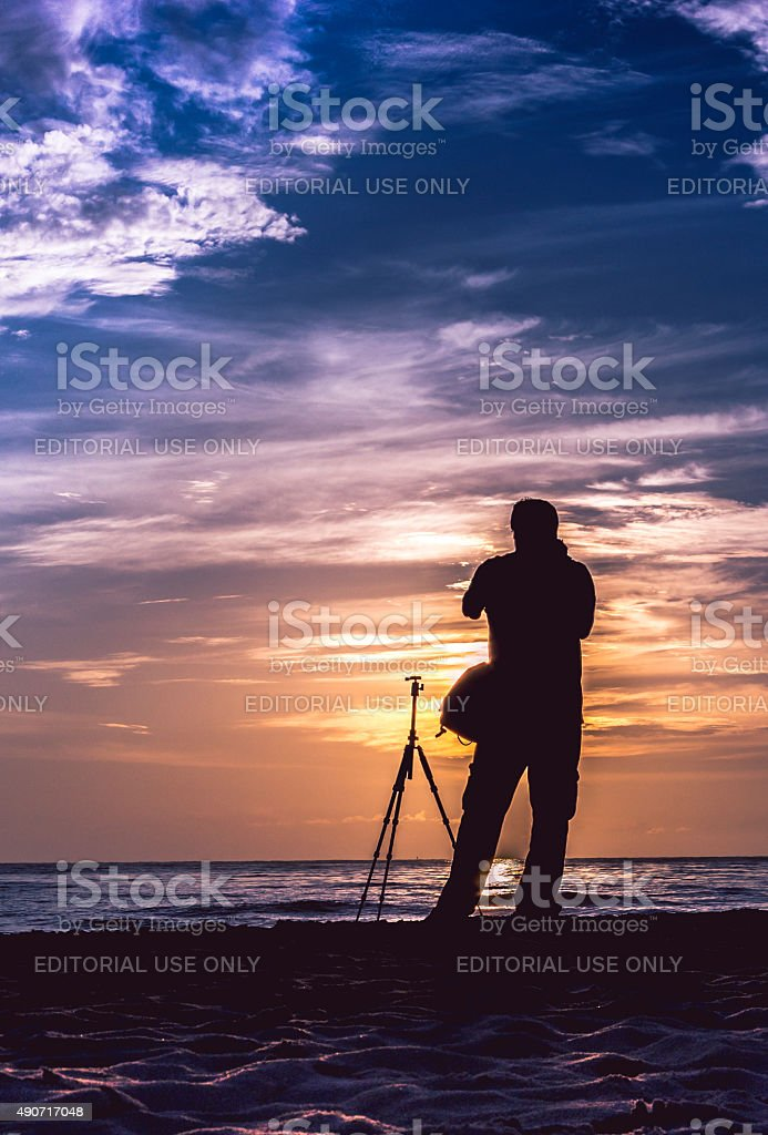 The beauty of the sunrise, and photographer. stock photo