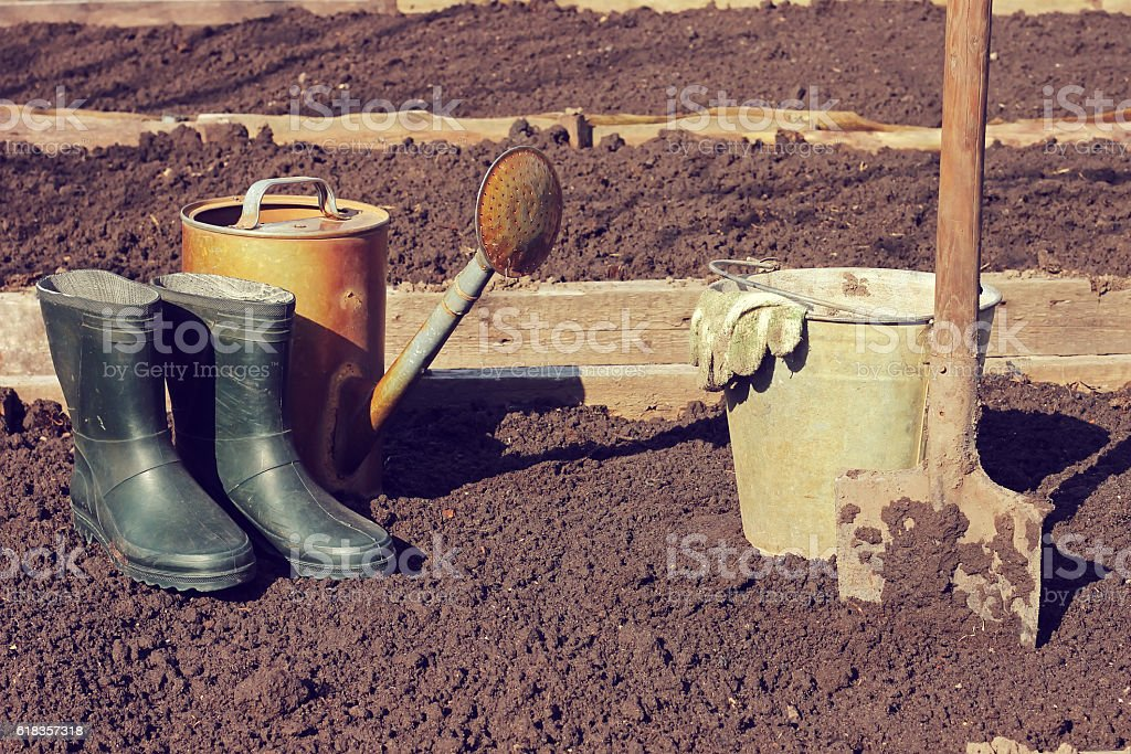 The beginning of the summer season: boots,  shovel,   garden. stock photo