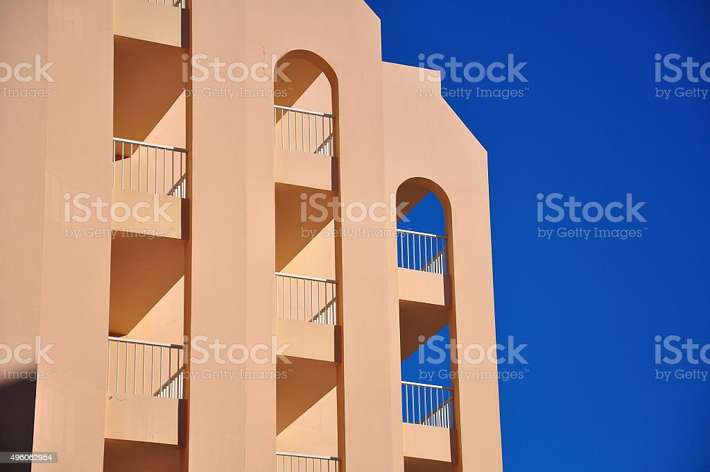 The beige color buildling and the blue sky(Contrast) stock photo