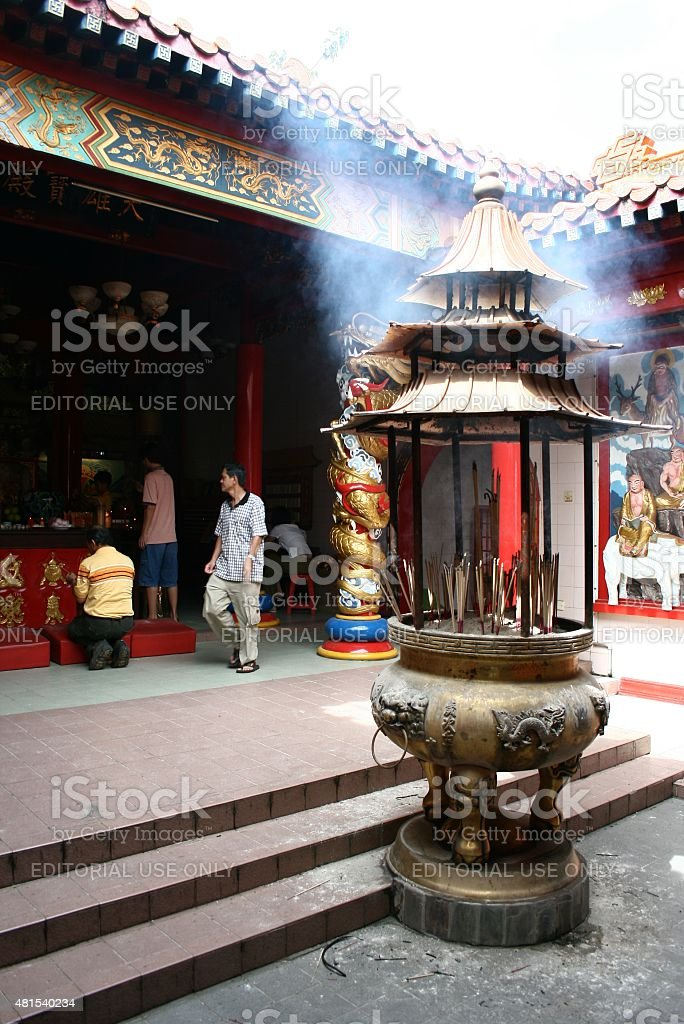 The believers pray at Muara Tebas Chinese temple, Kuching, Sarawak stock photo