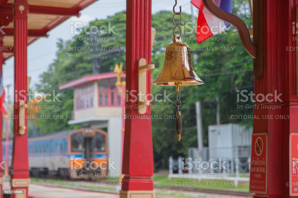 The bell and the train in Hua Hin Railway Station, Thailand stock photo