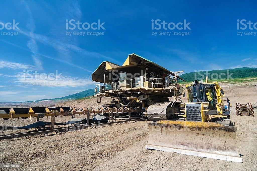 the belt conveyor and bulldozer royalty-free stock photo