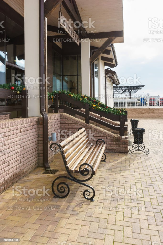 TAMAN, TEMRYUK DISTRICT, KRASNODAR REGION, RUSSIA - January 04.2017: The bench at the entrance to the store on a city street stock photo