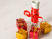 the best gift- money. Gifts on wooden background.