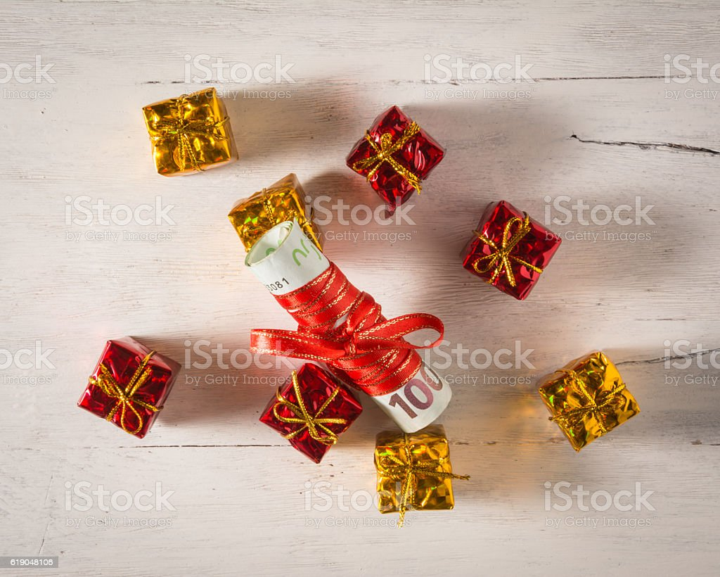 the best gift- money. Gifts on wooden background. top view stock photo