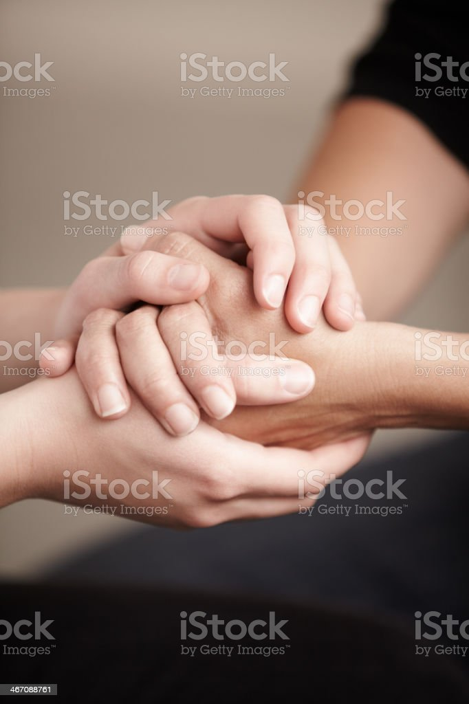 Consoling hands stock photo