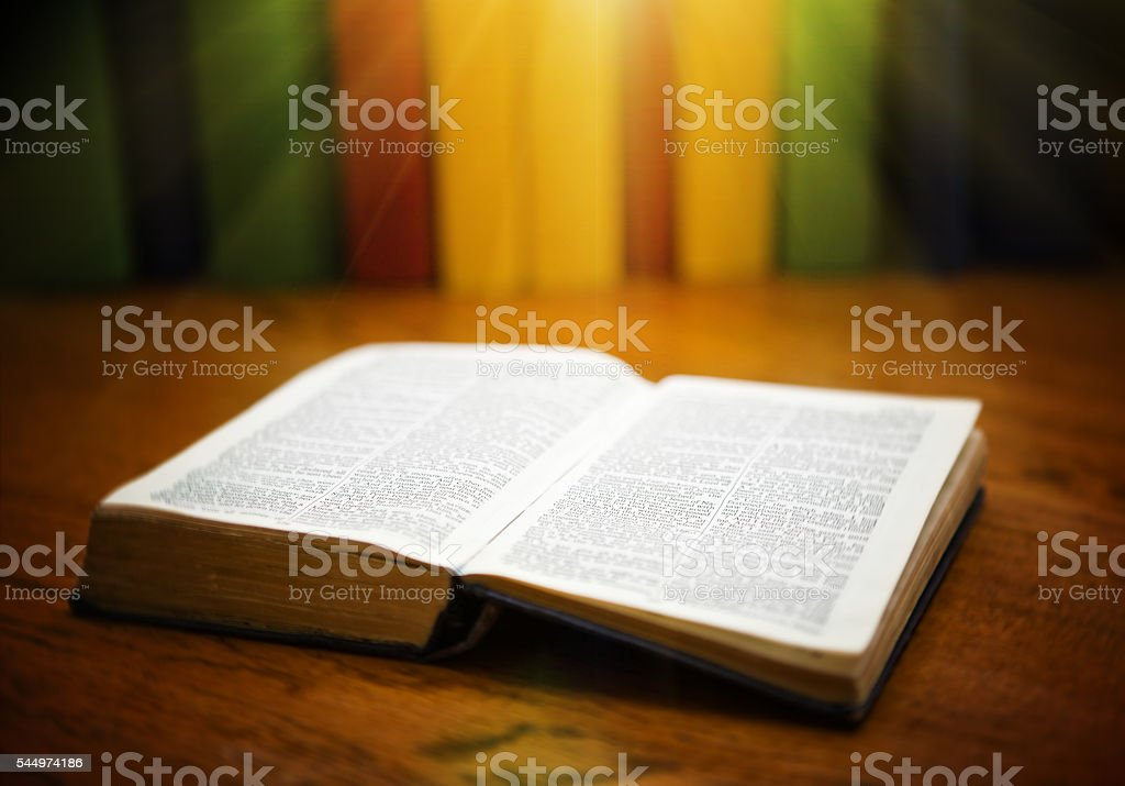 The Bible, open at the Book of Revelation stock photo