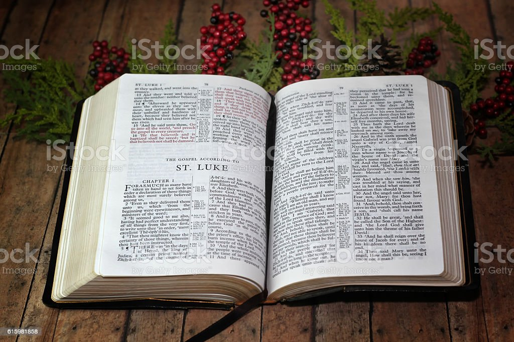 The Bible Opened to  Book of Luke with Christmas decor stock photo