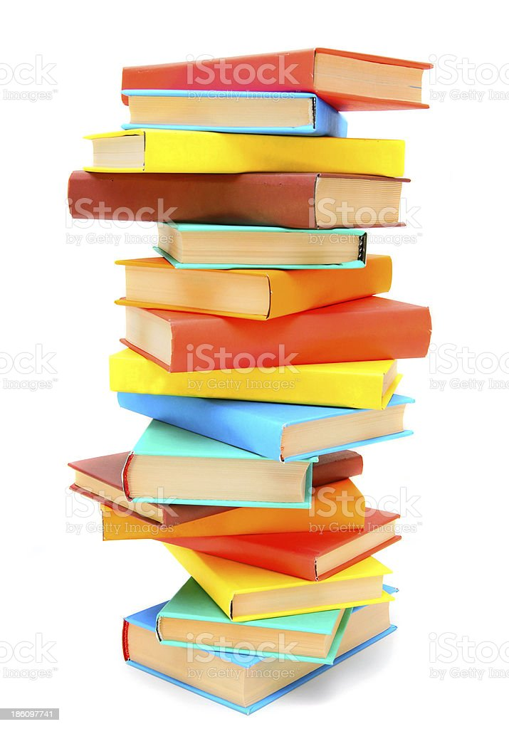 The big pile of multi-coloured books. On a white background. royalty-free stock photo