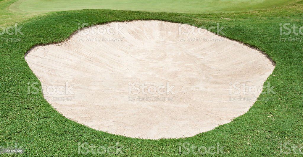 The big sand bunker on the beautiful golf course stock photo