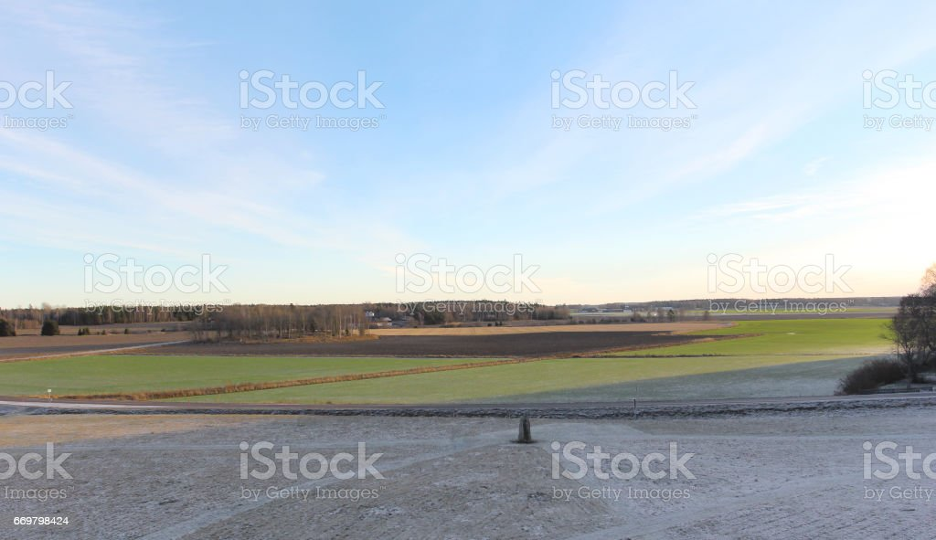 The big stones standing in the snow field in winter stock photo