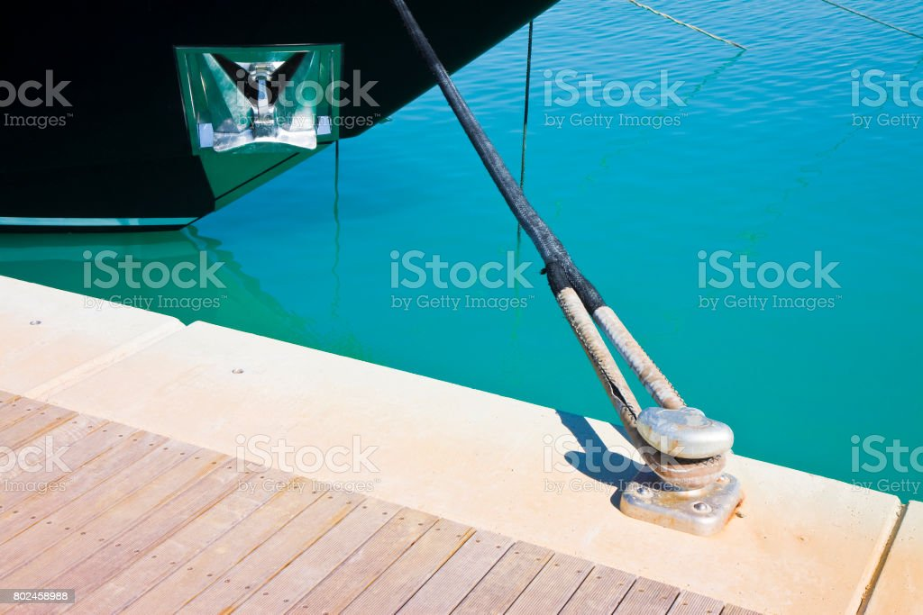 The black bow of a moored boat stock photo