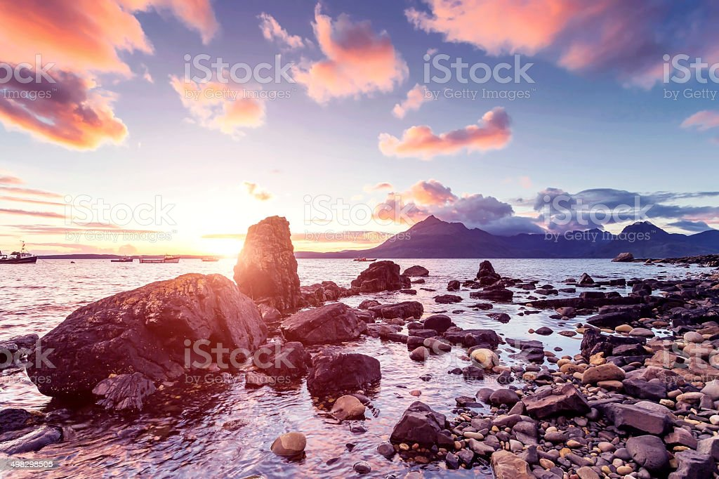 The Black Cuillins mountain range in Elgol at sunset stock photo