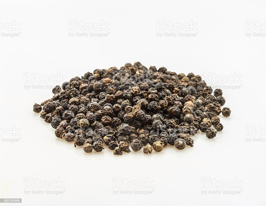 The black pepper spices on white background. stock photo