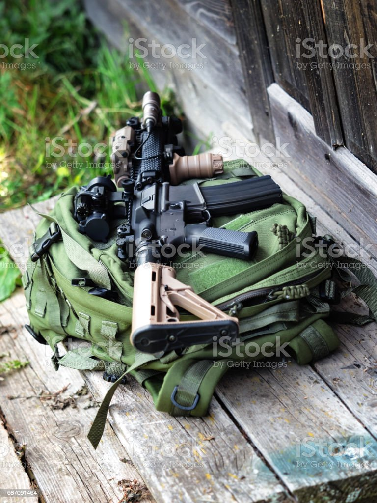 The Black Rifle and green backpack, shallow depth of field stock photo