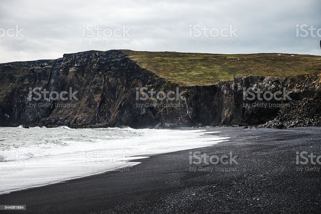 The black sand beach stock photo