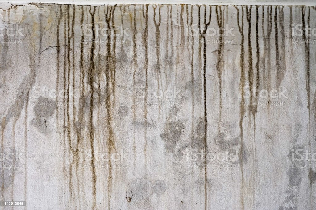 The black stains on the cement wall are dirty. stock photo