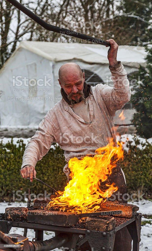 The Blacksmith Working stock photo