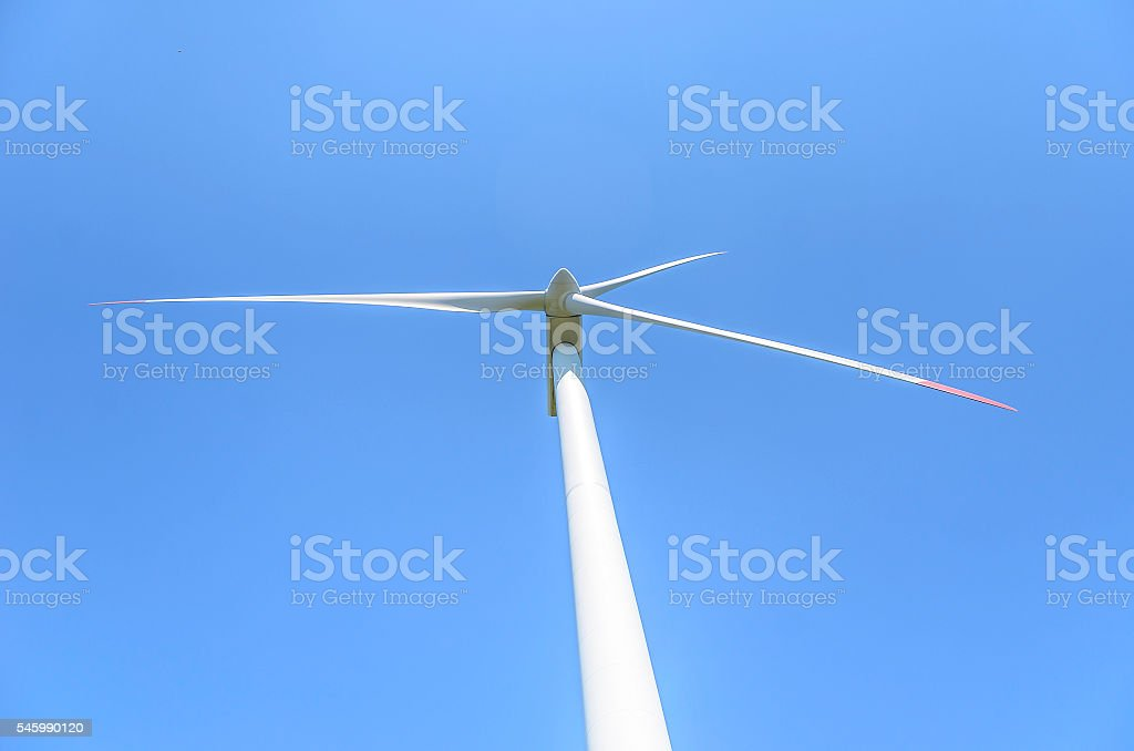 The blades of the wind motor against the sky. stock photo