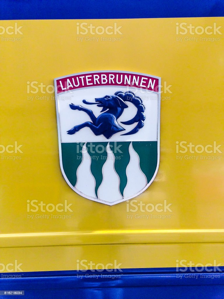 The blazon of the municipal Lauterbrunnen Coat of Arms,  is Per fess Argent a Semi Ibex rampant couped Sable and Vert three Piles wavy issuant from base of the first. The three stripes represent three famous waterfalls around the village. Switzerland, Eur stock photo