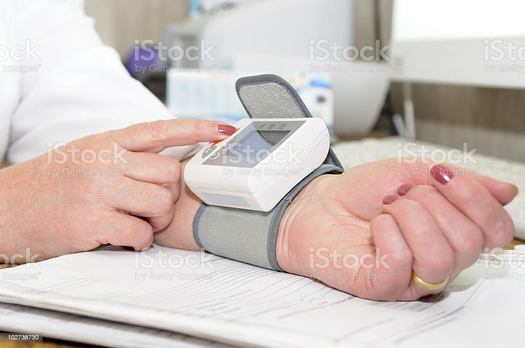 The blood pressure measuring process royalty-free stock photo
