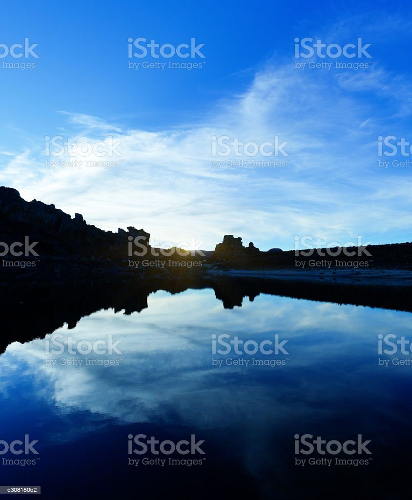 The Blue hour: Twilight sky reflected in calm water stock photo