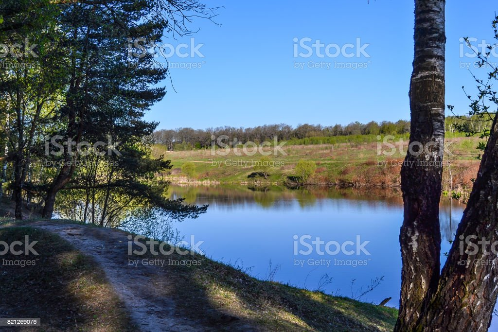 The blue water of the river and the blue sky without clouds. A place to relax outside the city. stock photo