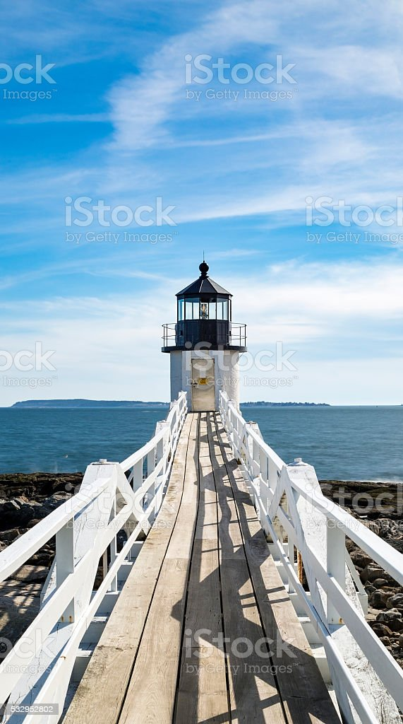 The boardwalk at Marshall Point Light in Port Clyde, Maine stock photo