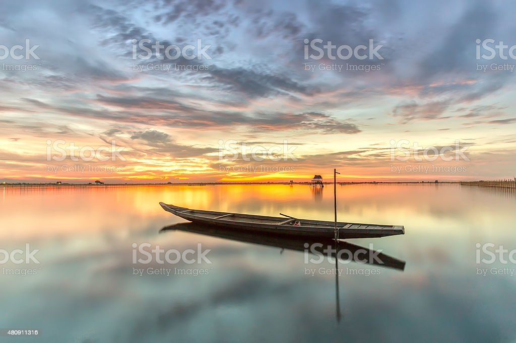 The boat alone in the twilight began to sunset stock photo