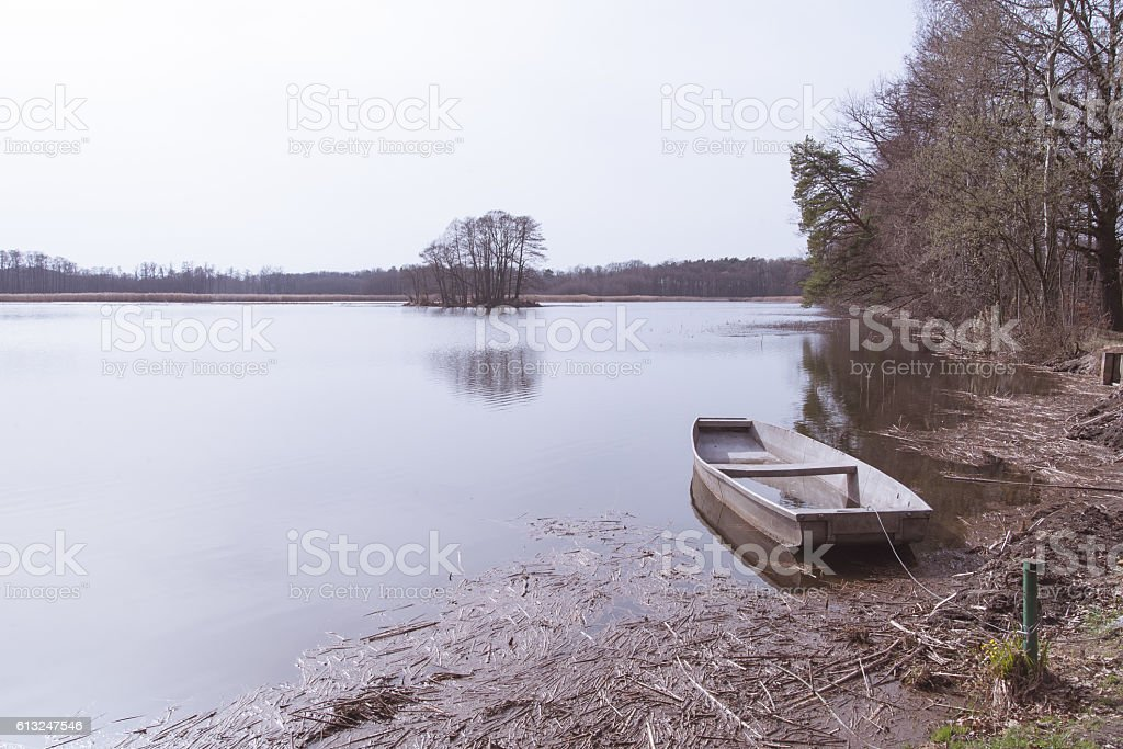 The boat moored at the lake shore. stock photo