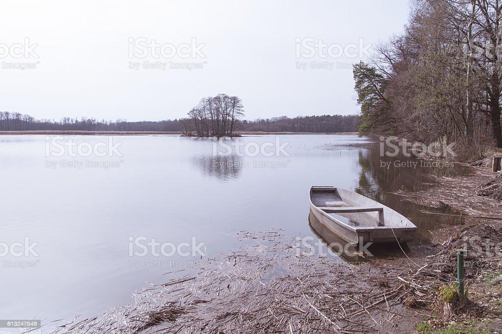 The boat moored at the lake shore. stock photo