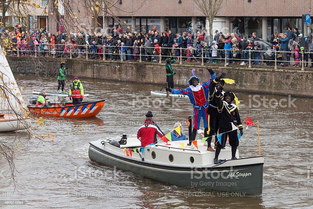 The boat with helpers of Sinterklaas arrived in Leeuwarden stock photo