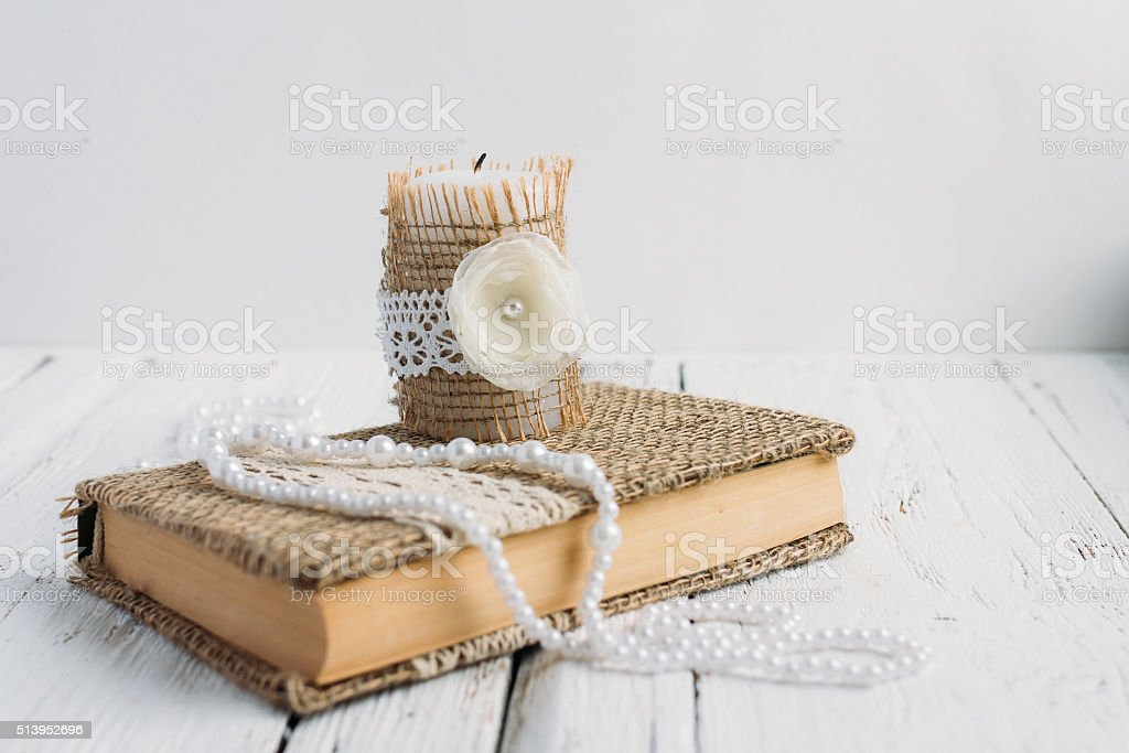 The book is in rustic style on a white table stock photo