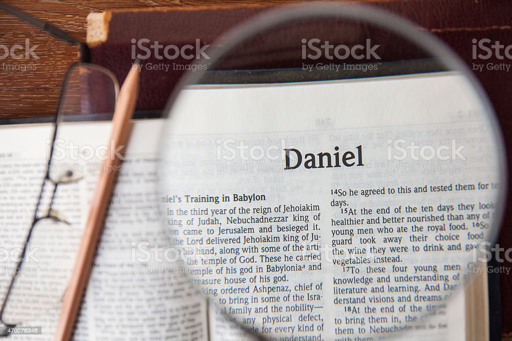 the book of Daniel Reading The New International Version stock photo
