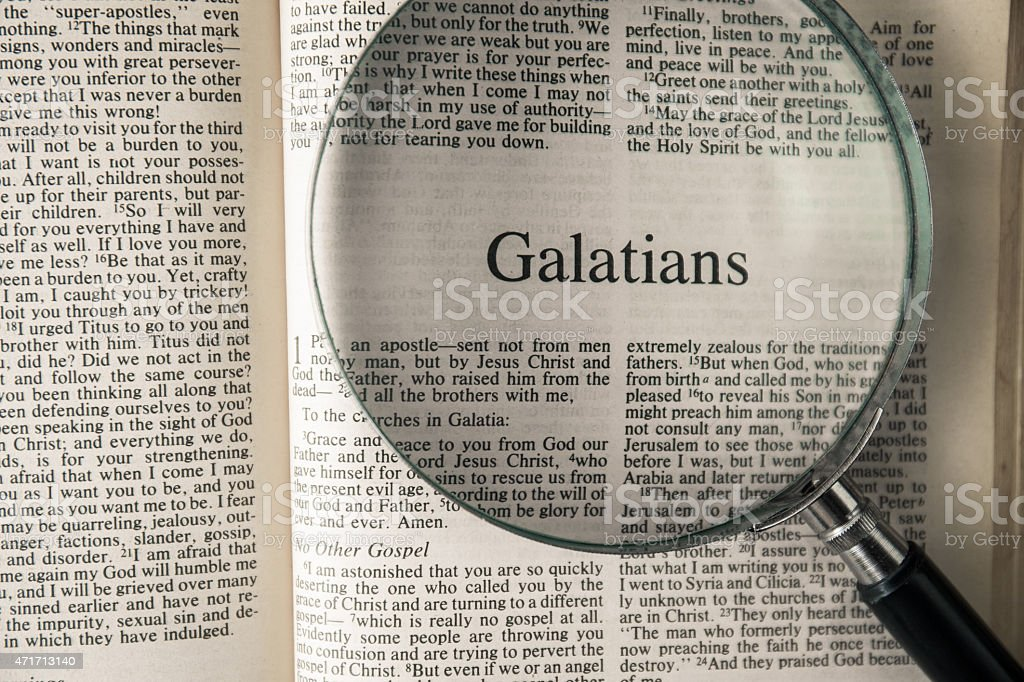 the book of Galatians Reading The New International Version stock photo