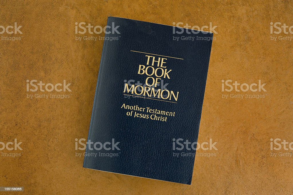 The Book of Mormon on an orange background stock photo